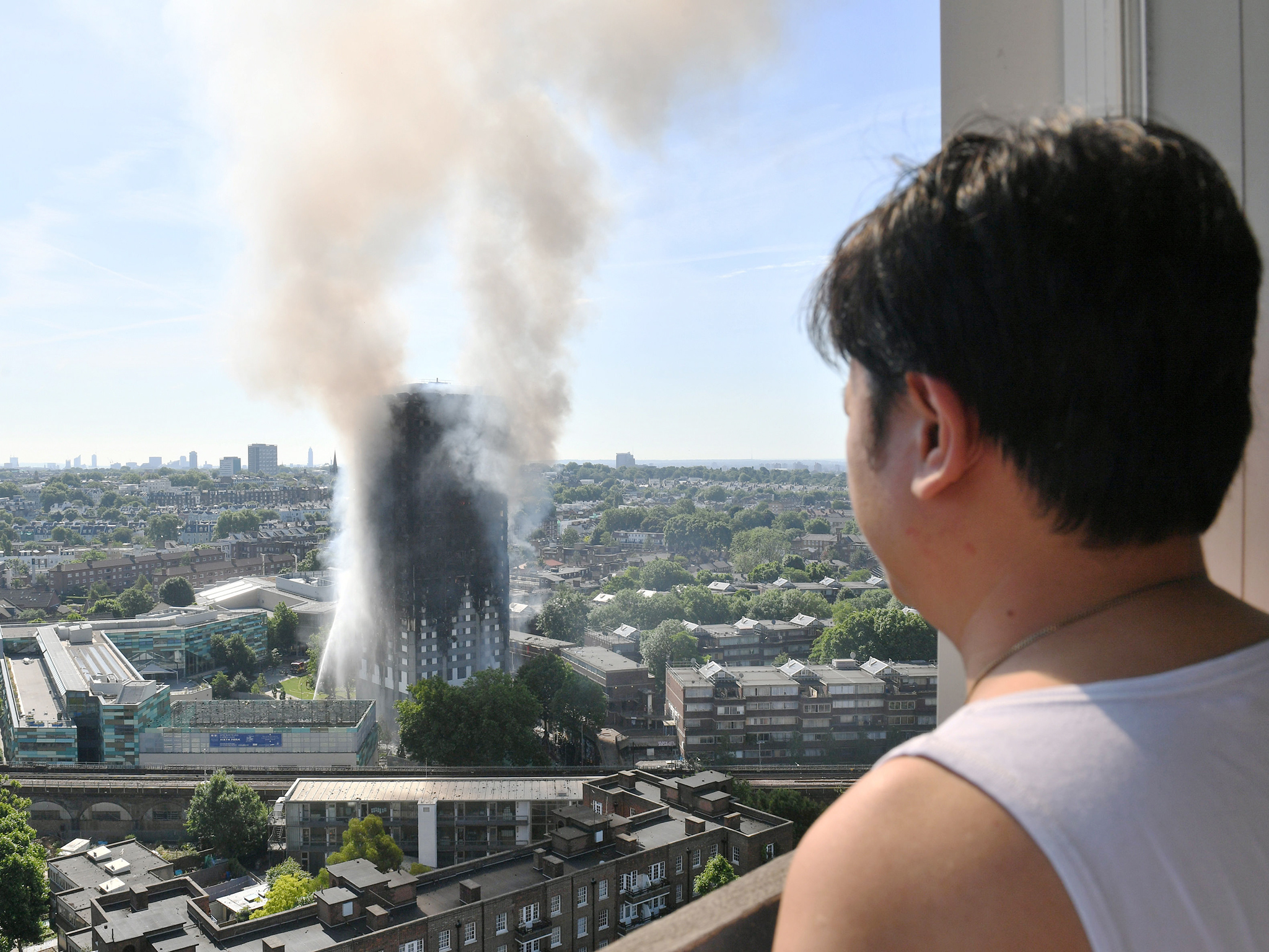 12 people have died in a west London tower block fire. All that remains of Grenfell Tower is a charred shell.. fire survivors describe horror