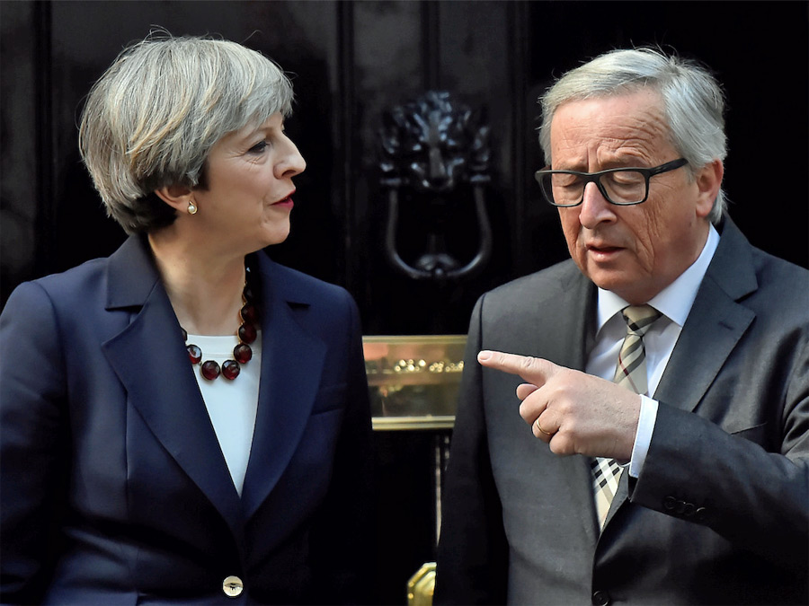 Britain's Prime Minister Theresa May welcomes European Commission President Jean-Claude Juncker to Downing Street in London, Britain